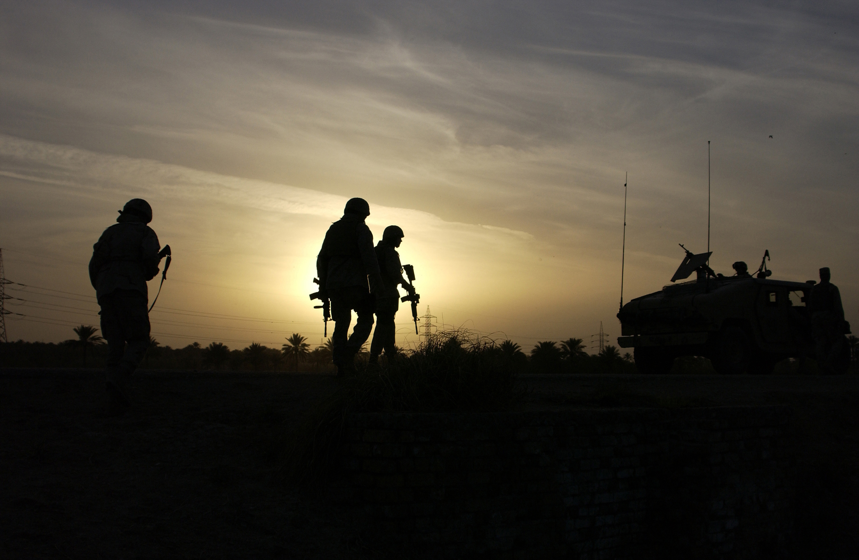 Marines with thermal rifle scopes at sundown